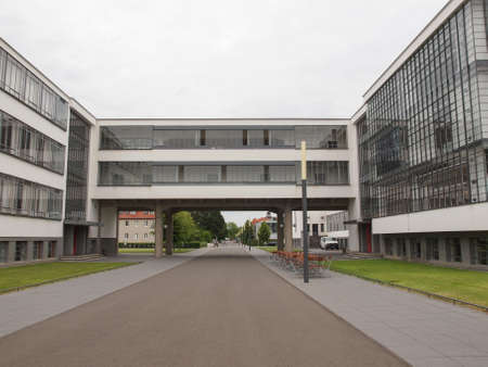rationalist: DESSAU, GERMANY - JUNE 13, 2014: The Bauhaus art school iconic building designed by architect Walter Gropius in 1925 is a listed masterpiece of modern architecture Editorial