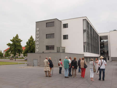 bauhaus: DESSAU, GERMANY - JUNE 13, 2014: Visitors on an official guided tour of the Bauhaus building Editorial