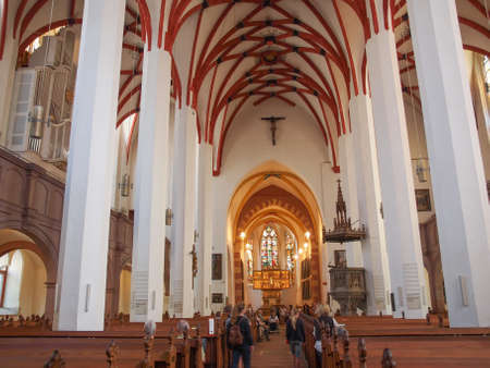 worked: LEIPZIG, GERMANY - JUNE 12, 2014: People visiting the Thomaskirche St Thomas Church where Johann Sebastian Bach worked as a Kapellmeister and the current location of his remains