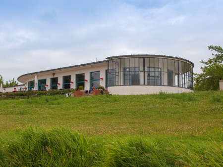 carl: DESSAU, GERMANY - JUNE 13, 2014: Kornhaus meaning Granary is a restaurant designed by Carl Fieger in 1929 on the river Elbe in Dessau Rosslauer belonging to the Bauhaus