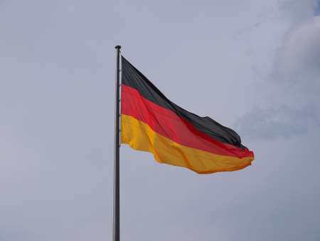 The national German flag of Germany over blue sky photo