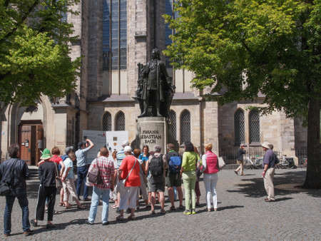 neues: LEIPZIG, GERMANY - JUNE 12, 2014: People visiting the Neues Bach Denkmal new Bach monument front of the St Thomas Kirche church where Johann Sebastian Bach is buried