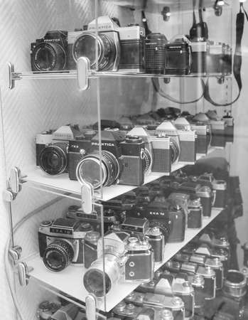 xx century: DRESDEN, GERMANY - JUNE 14, 2014: Many vintage models of Praktica and Exa SLR cameras built in the DDR German Democratic Republic in early to mid XX century