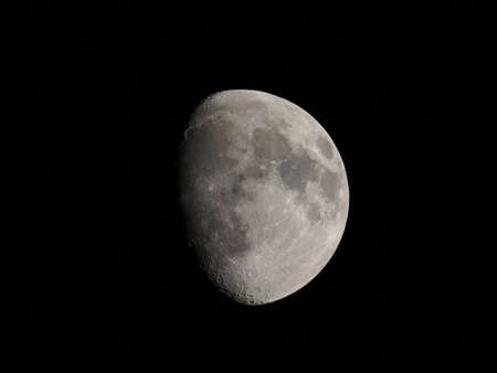 waxing gibbous: Waxing gibbous moon over dark sky at night