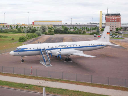 turboprop: LEIPZIG, GERMANY - JUNE 14, 2014: Ilyushin IL-18 aka Coot large turboprop Soviet airliner aircraft from 1957 in display in front of Flughafen Leipzig Hall airport Editorial