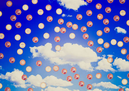 Vintage retro looking Euro coins from all European countries raining over metaphysical blue sky background photo