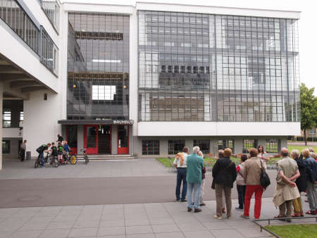 guided: DESSAU, GERMANY - JUNE 13, 2014: Visitors on an official guided tour of the Bauhaus building Editorial