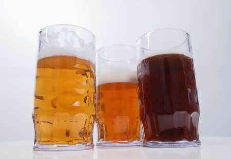 Many glasses of German beers including weiss dunkel and lager
