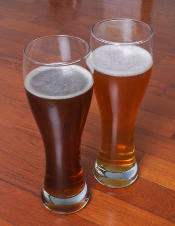 Two glasses of German dark and white weizen beer on the floor for a romantic rendezvous