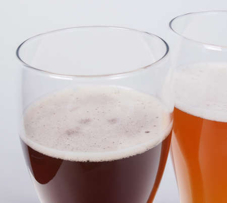 Two glasses of German dark and white weizen beer