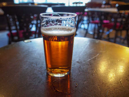 ale: A pint of English ale beer in a pub Stock Photo