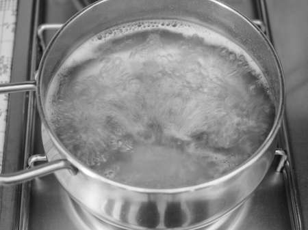 Pasta in boiling water in a pan photo