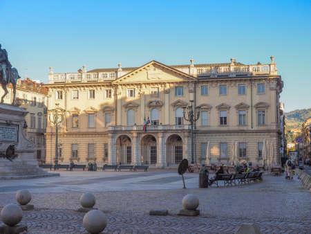 verdi: TURIN, ITALY - OCTOBER 22, 2014: People seated in front of Conservatorio Giuseppe Verdi music school