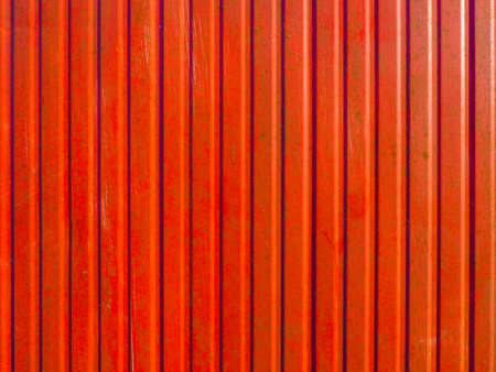 Red corrugated steel plate useful as a background