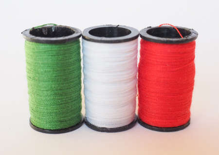 sewing kit: Sewing kit including thread spools of three different colours in the shape of the Italian flag Stock Photo