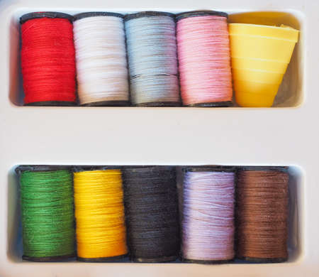 sewing kit: Travel sewing kit including thread spools of many different colours and thimble Stock Photo