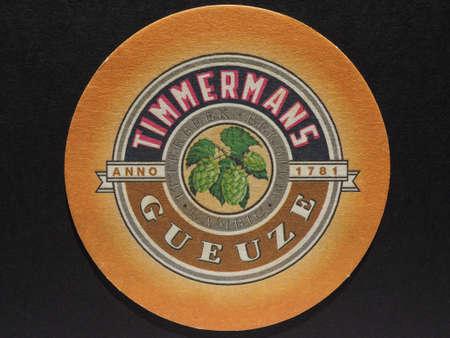 belgie: BRUSSELS, BELGIUM - DECEMBER 11, 2014: Beermat of Belgian beer Timmermans Gueuze