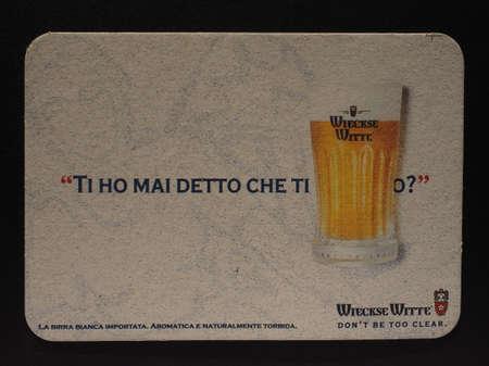 weiss: BRUSSELS, BELGIUM - DECEMBER 11, 2014: Beermat of Belgian weiss beer Wieckse Witte