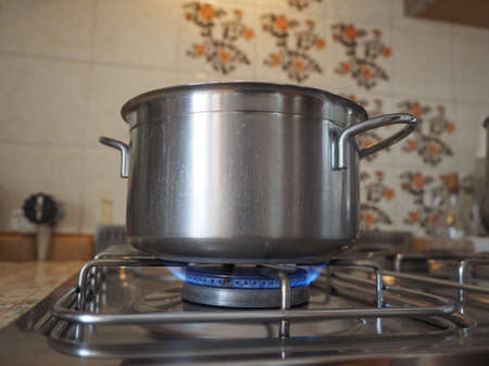 gas cooker: Detail of a saucepot on a gas cooker Stock Photo