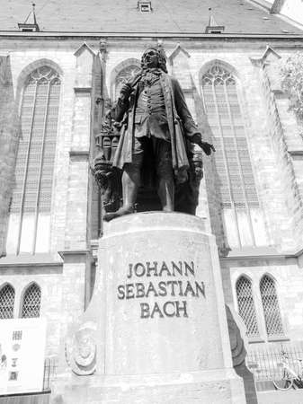 neues: The Neues Bach Denkmal meaning new Bach monument stands since 1908 in front of the St Thomas Kirche church where Johann Sebastian Bach is buried in black and white Editorial
