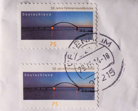 2 50: BERLIN, GERMANY - JANUARY 2, 2015: German stamp to celebrate 50 years since the construction of the Fehmarnsundbruecke bridge