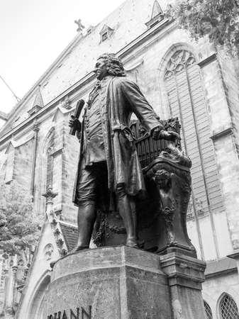 neues: The Neues Bach Denkmal meaning new Bach monument stands since 1908 in front of the St Thomas Kirche church where Johann Sebastian Bach is buried in Leipzig Germany in black and white