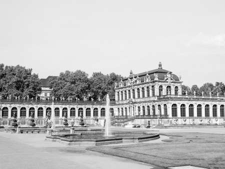 addition: Dresdner Zwinger rococo palace designed by Poeppelmann in 1710 as orangery and exhibition gallery of Dresden Court completed by Gottfried Semper with the addition of the Semper Gallery in 1847 in black and white