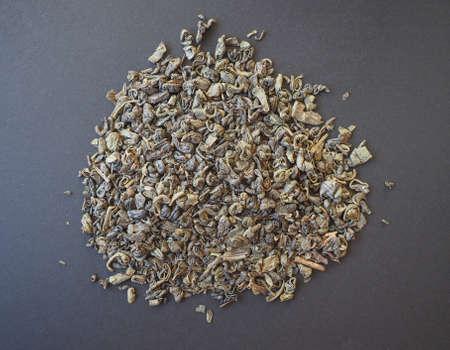 gunpowder tea: Loose gunpowder green tea leaves Stock Photo
