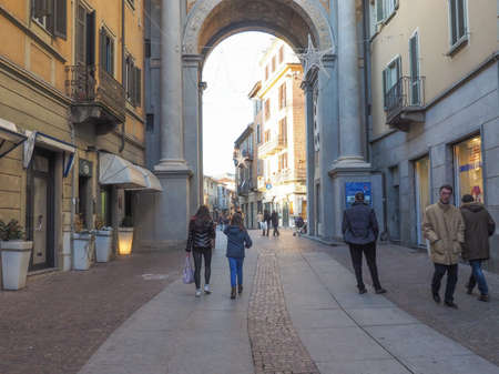city centre: CHIERI, ITALY - JANUARY 12, 2015: Tourists visiting Via Vittorio Emanuele high street in the city centre Editorial
