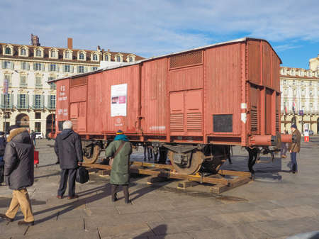 levi: TURIN, ITALY - JANUARY 23, 2015: People visiting an holocaust train for deportation of Jews to concentration forced labour and extermination camps to mark the Primo Levi exhibition in Piazza Castello Editorial