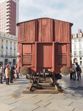 extermination: TURIN, ITALY - JANUARY 23, 2015: People visiting an holocaust train for deportation of Jews to concentration forced labour and extermination camps to mark the Primo Levi exhibition in Piazza Castello Editorial