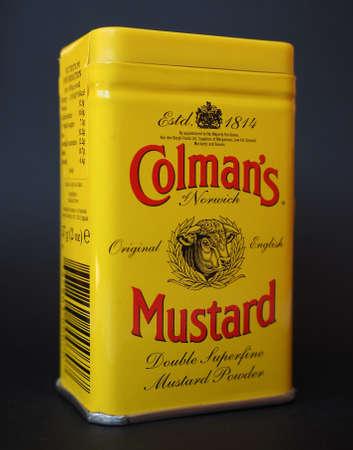 uk cuisine: NORWICH, UK - JANUARY 6, 2015: Colman English Mustard double superfine powder