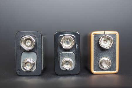 9v battery: Three 9V batteries over black background