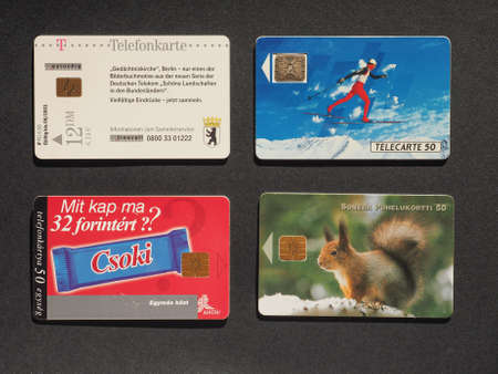 suomi: BERLIN, GERMANY - JANUARY 6, 2015: European telephone cards from Germany, France, Finland and Hungary
