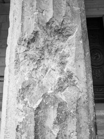 raid: Column damaged by air raid bombing during WW2 in Berlin Museumsinsel in black and white