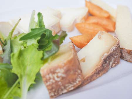 cheese platter: Cheese platter with a selection of many fine handmade cheeses Stock Photo