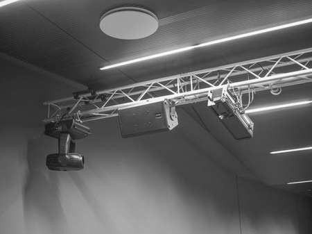 gig: Stage lights and loudspeakers used in live gig concert in an auditorium Stock Photo