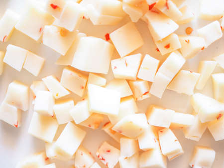 diced: Diced cheese with red hot chilli peppers Stock Photo