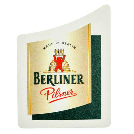 pilsner: BERLIN, GERMANY - MARCH 15, 2015: Beermat of German beer Berliner Pilsner  isolated over white background