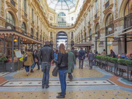 restored: MILAN, ITALY - MARCH 28, 2015: People visiting the newly restored Galleria Vittorio Emanuele II