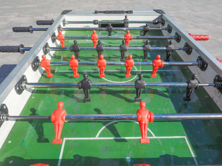 kicker: Table football aka table soccer, foosball from the German Tischfussball, baby-foot or kicker table-top game and sport Stock Photo