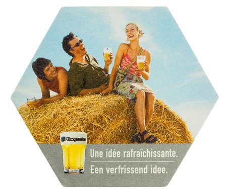 belgie: BRUSSELS, BELGIUM - MARCH 15, 2015: Beermat of Belgian beer Hoegaarden isolated over white background