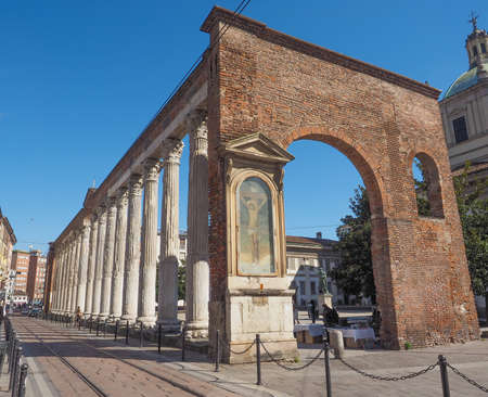 lawrence: MILAN, ITALY - MARCH 28, 2015: Colonne di San Lorenzo meaning St Lawrence columns, ancient Roman ruins Milan Italy