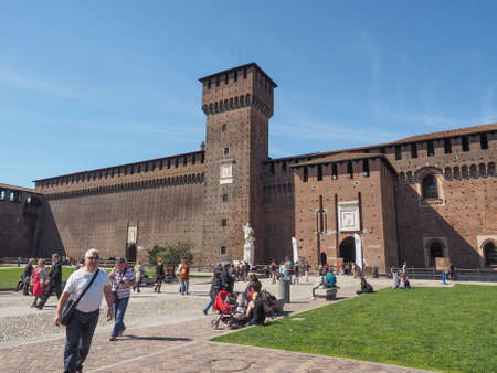 sforza: MILAN, ITALY - MARCH 28, 2015: People visiting the Sforza Castle aka Castello Sforzesco which is the oldest castle in town