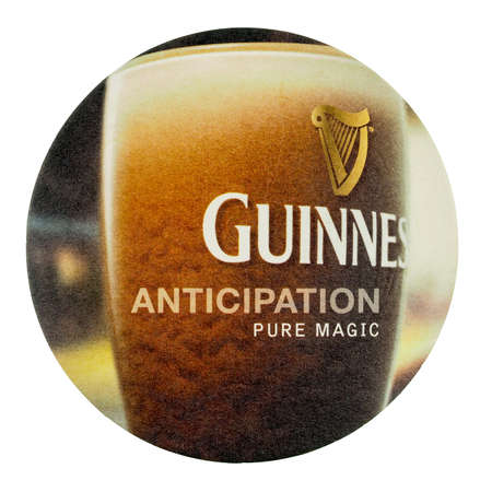 guinness beer: DUBLIN, IRELAND - MARCH 15, 2015: Beermat of Irish beer Guinness isolated over white background