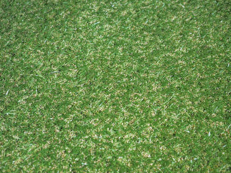 synthetic: Green artificial synthetic grass meadow texture useful as a background Stock Photo