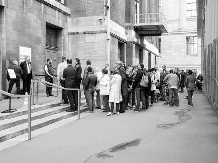 antiquities: BERLIN, GERMANY - MAY 10, 2014: People queuing in front of the Pergamon Museum of antiquities on the Museumsinsel in black and white