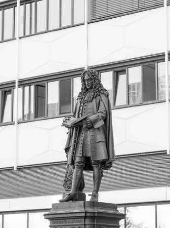 philosopher: The Leibniz Denkmal monument to German philosopher Gottfried Wilhelm Leibniz stands in the campus of Leipzig University in black and white