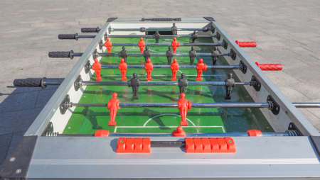 foosball: Table football aka table soccer, foosball from the German Tischfussball, baby-foot or kicker table-top game and sport Stock Photo