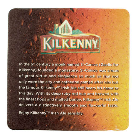 DUBLIN, IRELAND - MARCH 15, 2015: Beermat of Irish beer Kilkenny isolated over white background